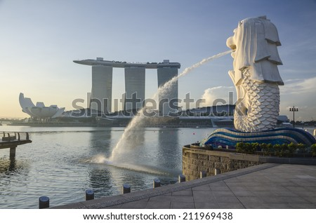 SINGAPORE - MAY 12: View of Merlion Statue on May 12, 2014 in Singapore. A mythical creature with the head of a lion and the body of a fish, used as a mascot and national personification of Singapore. - stock photo