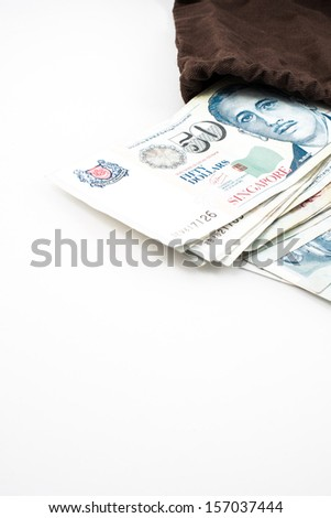 singapore money in bag - stock photo