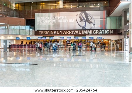 SINGAPORE - NOV 24 : Changi International Airport on November 24, 2014 in Singapore. Changi Airport serves more than 100 airlines operating 6,100 weekly flights connecting Singapore to over 220 cities - stock photo