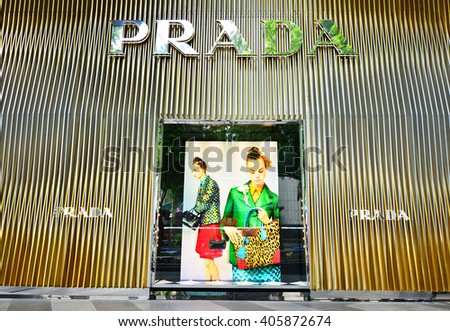 SINGAPORE - NOV 18: Prada store at ION Orchard shopping mall in Singapore on November 18, 2015 in Singapore. Ion's Media Facade is a multi-sensory canvas media wall made with cutting-edge technology. - stock photo
