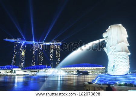 SINGAPORE - NOV 05 :The Merlion fountain Nov 05, 2012 in Singapore.Merlion is a mythical creature with the head of a lion and the body of a fish,and is a symbol of Singapore.  - stock photo