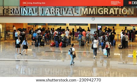 SINGAPORE - NOV 12: View of immigration control at Changi International Airport on Nov 12, 2011 in Singapore. Changi is the main aviation hub in SE Asia, handling 66 million passengers annually. - stock photo