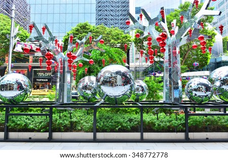 SINGAPORE - NOVEMBER 17, 2015: Day view of Christmas Decoration at Singapore Orchard Road. The street with colourful christmas trees, bells, baubles, ball, ribbon, star & dressed-up shopping centres. - stock photo