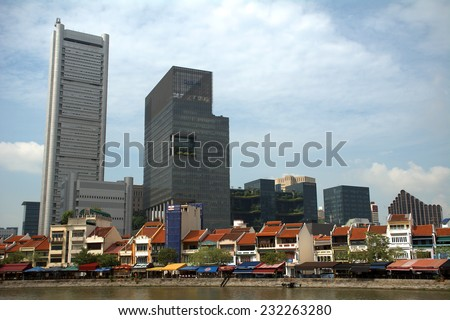 SINGAPORE - NOVEMBER 7: Downtown with skyscrapers at November 7, 2014 in Singapore. The British colonized the territory at the 18th century and started to build Singapore. - stock photo