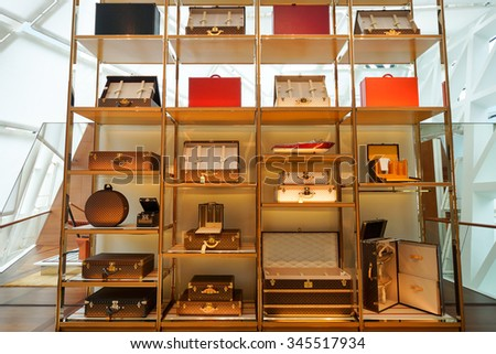 SINGAPORE - NOVEMBER 08, 2015: inside the Louis Vuitton store. Louis Vuitton is a French fashion house, one of the world's leading international fashion houses - stock photo