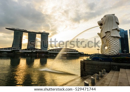 SINGAPORE - NOVEMBER 23, 2016: silhouette of Merlion Statue at Marina Bay against the sunrise. Merlion is a well known marketing icon of Singapore depicted.