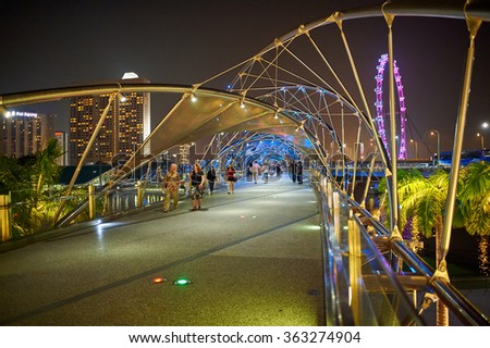 SINGAPORE - NOVEMBER 08, 2015: The Helix Bridge at night. The Helix Bridge is a pedestrian bridge linking Marina Centre with Marina South in the Marina Bay area in Singapore - stock photo
