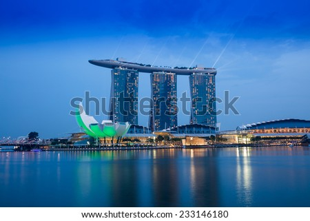 SINGAPORE-NOVEMBER 1: The Marina Bay Sands Resort Hotel in night time on November 1, 2014 in Singapore. It is an integrated resort and the world's most expensive standalone casino.  - stock photo