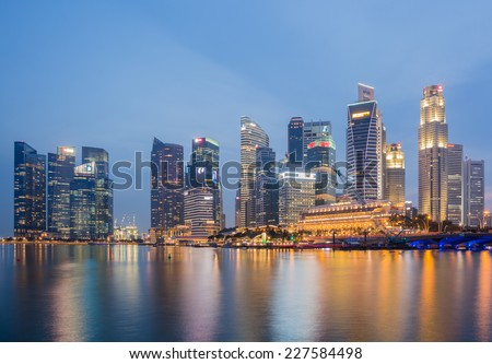 SINGAPORE-NOVEMBER 1: The Singapore skyline in twilight time on November 1,2014. Singapore is the 14th largest exporter and the 15th largest importer in the world