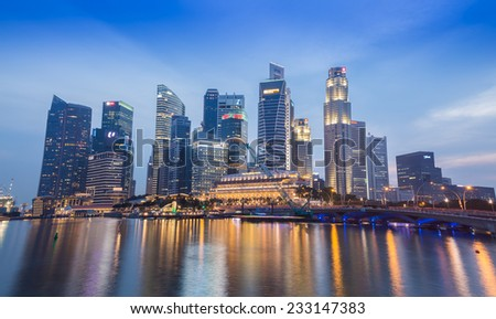 SINGAPORE-NOVEMBER 01: The Singapore skyline in twilight time on November 01,2014. Singapore is the 14th largest exporter and the 15th largest importer in the world