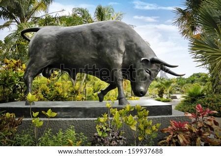 SINGAPORE-OCT 23: A Black Charging Bull sculpture decoration at Gardens by the Bay on Oct 23, 2013 in Singapore. Sculpture by Anna Chiara Spellini from Italy. Donated By Bank of America Merrill Lynch.