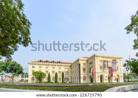 SINGAPORE - OCT 19, 2014: Asian Civilisations Museum in Singapore. Collection includes artifacts reflecting the cultural background of Singapore including ceramics, basketry, and textiles. - stock photo
