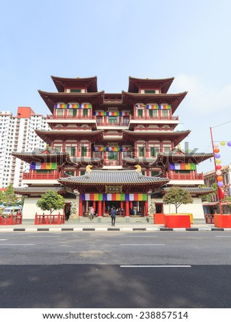 SINGAPORE - OCT 12, 2012: Buddha Tooth Relic Temple in Chinatown. The temple is based on the Tang dynasty architectural style and built to house the tooth relic of the historical Buddha. - stock photo