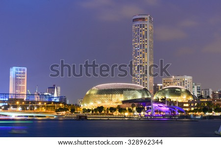 Singapore - Oct 10, 2015. Night view of business district in Singapore. Trade in Singapore has benefited from the extensive network of trade agreements Singapore has passed. - stock photo