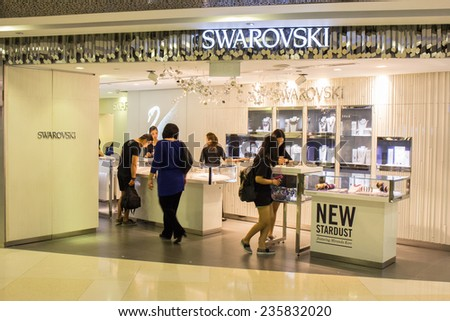 SINGAPORE - OCT 19 : Swarovski Store at ION Orchard shopping mall on October 19, 2014. Swarovski is an Austrian producer of luxury cut lead glass (crystal). - stock photo