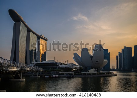 SINGAPORE - Oct 27, 2014: The Helix Bridge, Marina bay sands & Artscience museum at night. Marina Bay Sand iconic design has transformed Singapore's skyline. Designed by architect Moshe Safdie.