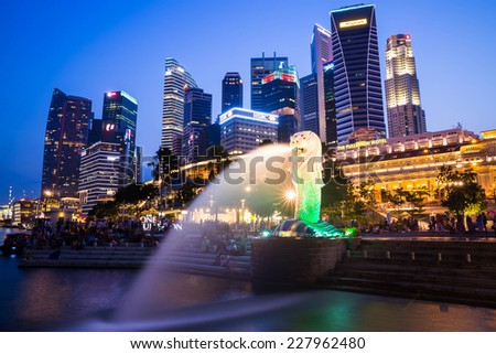 SINGAPORE-Oct 25: The Merlion fountain and Marina Bay Sand on Oct. 25, 2014. Merlion is an imaginary creature with a head of a lion and the body of a fish and symbol of Singapore.