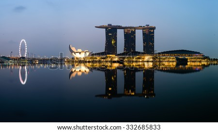 SINGAPORE � OCT 9, 2015: View of Singapore famous landmarks and tourist attractions at blue hour from Merlion Park. Singapore Flyer, Marina Bay Sands, ArtScience Museum, Central Business District(CBD)
