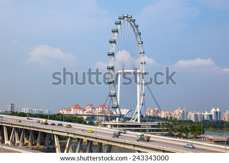 SINGAPORE - Oct 28: View of the Singapore Flyer from Marina Bay Sands on Oct 28, 2014 in Singapore. At a height of 165m, Singapore Flyer is the largest Giant Observation Wheel in the world.