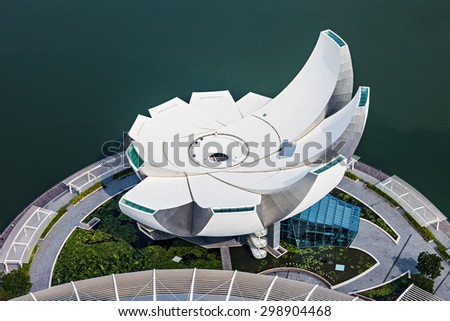 SINGAPORE - OCTOBER 18, 2014: ArtScience Museum is one of the attractions at Marina Bay Sands, an integrated resort in Singapore.  - stock photo