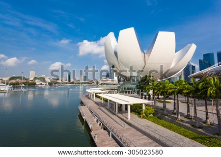 SINGAPORE - OCTOBER 17, 2014: ArtScience Museum is one of the attractions at Marina Bay Sands, an integrated resort in Singapore.  - stock photo