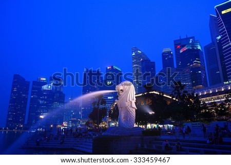 SINGAPORE - OCTOBER 24,2015: Financial district skyscrapers and Merlion at Marina bay. The Merlion is a traditional creature with a lion head and a body of a fish, seen as a symbol of Singapore.