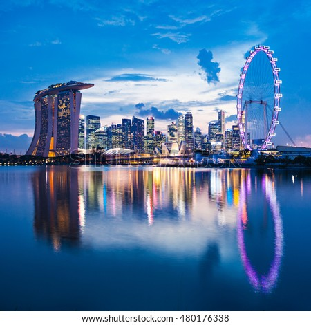 SINGAPORE - OCTOBER 16, 2014: Marina Bay Sands, Singapore Flyer and ArtScience Museum at sunset.