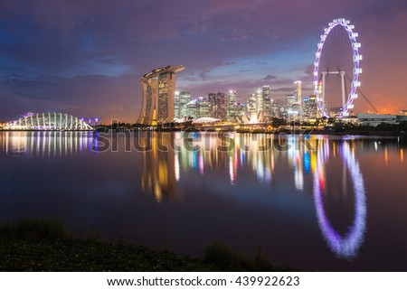 SINGAPORE - OCTOBER 16, 2014: Marina Bay Sands, Singapore Flyer, ArtScience Museum and Flower Dome at sunset.