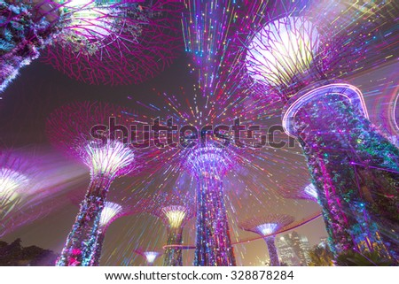 SINGAPORE OCTOBER 2: Night view of Supertree Grove at Gardens by the Bay on October 2, 2015 in Singapore. Spanning 101 hectares of reclaimed land in central Singapore, adjacent to the Marina Reservoir - stock photo