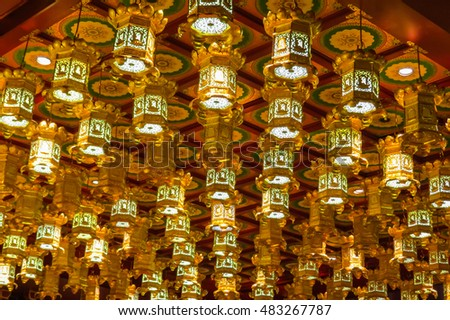 SINGAPORE, REPUBLIC OF SINGAPORE - JANUARY 09, 2014: Interior of the Buddhist temple. Buddha Tooth Relic Temple, Chinatown, Singapore city