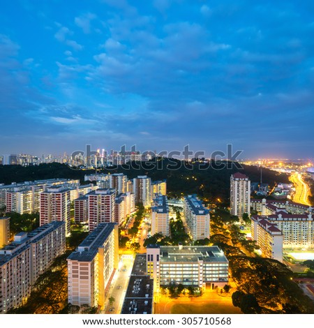 Singapore's skyline and HDB's at night.  - stock photo