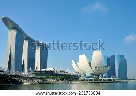SINGAPORE - SEP 8: The Marina Bay Sands Resort Hotel on Sep 8, 2014 in Singapore. It is an integrated resort and the worlds most expensive standalone casino property at S$8 billion. - stock photo