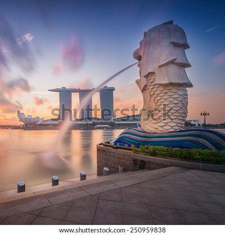 SINGAPORE-SEP 01, 2014: The Merlion fountain in front of the Marina Bay Sands hotel in Singapore. Merlion is a imaginary creature with the head of a lion,seen as a symbol of Singapore - stock photo
