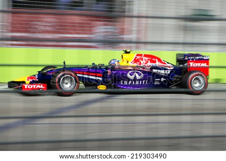 SINGAPORE - SEPTEMBER 20:  Daniel Ricciardo of the Infiniti Red Bull Renault clinching the third position in the qualifying round of the Singapore Grand Prix on SEPT 20, 2014 - stock photo