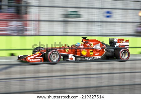 SINGAPORE - SEPTEMBER 20.  Fernando Alonso (ESP) Ferrari F14 T. Formula One World Championship, Rd14, Singapore Grand Prix, Marina Bay Street Circuit, Singapore, 20 September 2014 - stock photo
