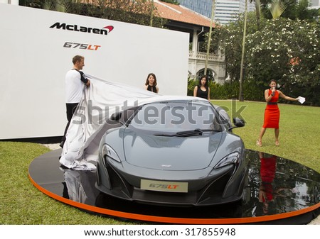 Singapore â?? September 18, 2015 : Inaugural launch of British McLaren 675LT by F1 driver Jenson Button at Raffles Hotel, Singapore - stock photo
