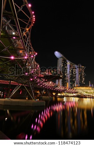 SINGAPORE - SEPTEMBER 17: Marina Bay Sands Resort Hotel and the Helix bridge on September 17, 2011 i Singapore. The resort is one of the most expensive stand alone casino property in the world.