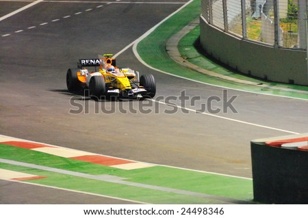 SINGAPORE - SEPTEMBER 26: Nelsinho Piquet entering pit lane in his Renault during first Formula One night race September 26, 2008 in Singapore