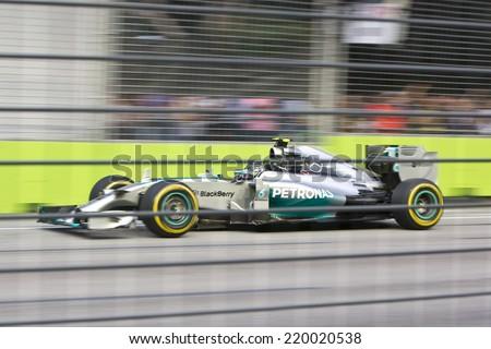SINGAPORE - SEPTEMBER 20:  Nico Rosberg (Ger) Mercedes Mercedes. Formula One World Championship, Singapore Grand Prix, Marina Bay Street Circuit, Singapore 20th SEPT 2014 - stock photo