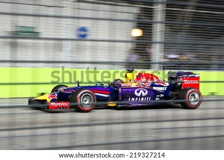 SINGAPORE - SEPTEMBER 20:  Sebastian Vettel,Toro Rosso Renault . Formula One World Championship, Singapore Grand Prix, Marina Bay Street Circuit, Singapore 20th SEPT 2014 - stock photo