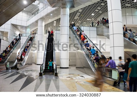 Singapore - September 13th, 2015: Unidentified people using underground MRT escalator in Singapore.