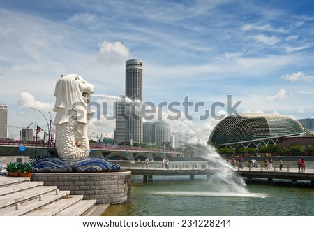 SINGAPORE - SEPTEMBER 20, 2010 - The Merlion fountain on the waterfront of Marina Bay is the symbol of Singapore - stock photo