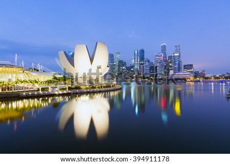 Singapore - Singapore April 10, 2014: The `Lotus flower` of the ArtScience Museum  and the Central business district of Singapore at the background.