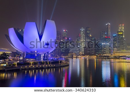 SINGAPORE, SINGAPORE - CIRCA SEPTEMBER 2015: Singapore city lights and ArtScience Museum at night, Singapore - stock photo