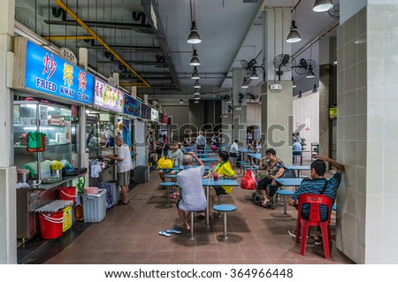 SINGAPORE/SINGAPORE - DEC 23, 2015: Amoy street food centre, hawker centre with people having their meals or waiting for food in the morning on Dec 23, 2015.