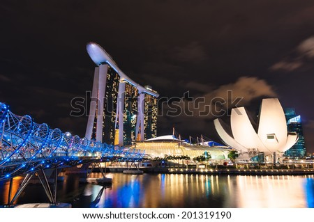 SINGAPORE, SINGAPORE - DECEMBER 22: The lights along Marina Bay and the Helix Bridge in Singapore. Photo taken December 22, 2013 in Singapore, Singapore. - stock photo