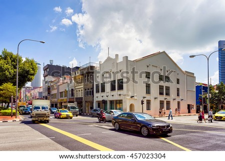 Singapore, Singapore - February 29, 2016: Car traffic and Shop houses in Clarke Quay in Singapore.