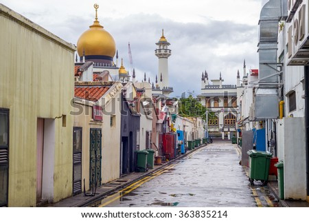Singapore, Singapore - January 2, 2016 : street view of singapore with Masjid Sultan. The mosque is considered one of the most important mosques in Singapore.  - stock photo