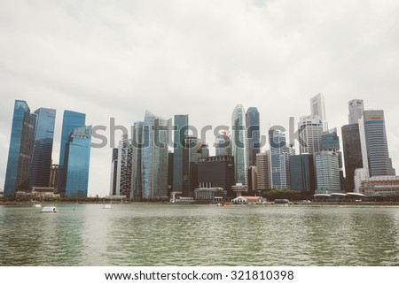 SINGAPORE, SINGAPORE - JULY 16 2015: View of downtown Singapore city. Singapore is one of the world's major commercial hubs.- with film filter effect