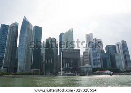 SINGAPORE, SINGAPORE - JULY 16 2015: View of downtown Singapore city. Singapore is one of the world's major commercial hubs.